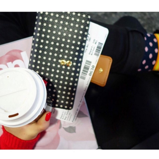 "She's got a sense of humor, uploading this shot and captioning ""Because if you don't upload a photo holding a coffee with your boarding pass... did you even go to the airport?"""