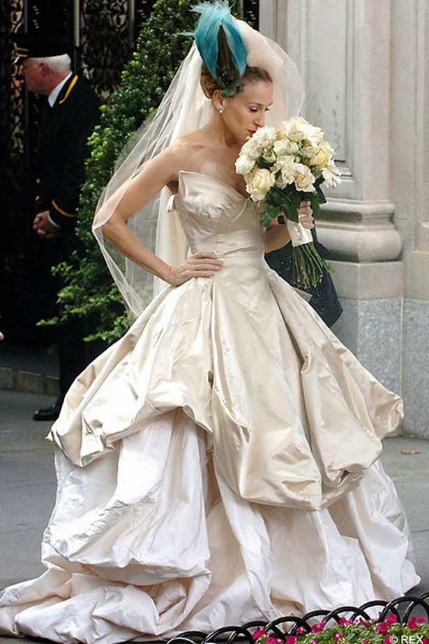 <em>Sex and the City.</em> Say what you will about the film, and about the bird on her head, but Carrie Bradshaw's Vivienne Westwood wedding gown was spectacular.