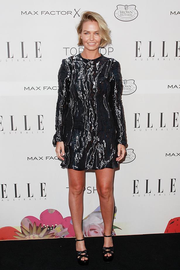 Lara Worthington in Saint Laurent heels and a metallic Ellery dress.