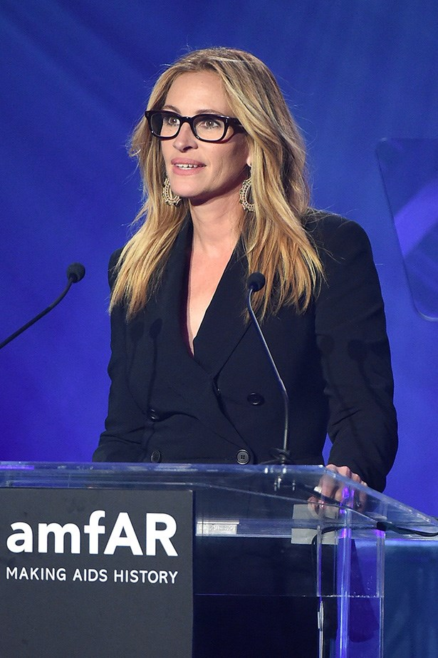 Julia Roberts speaks at the AmfAR Inspiration Gala in LA.