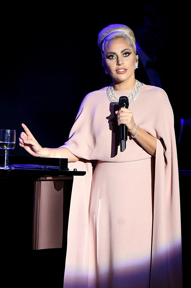 Lady Gaga performs at the AmfAR Inspiration Gala in LA.