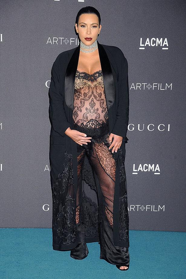 OK so this lace jumpsuit is next level in the journey that is Kim Kardashian's maternity style. We doff our hat.