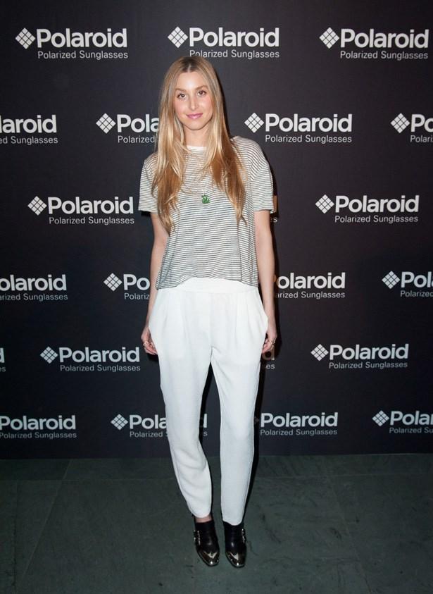 White drop-crotch pants and a striped tee.