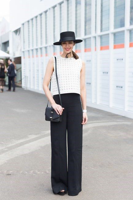 Name: Emily Hall Outfit: hat Lack of Colour, pants Scanlan Theodore, bag Victoria Beckman Race day: Stakes Day 2015 Location: Flemington, Melbourne