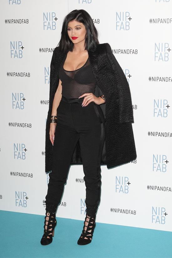 Kylie finishes this all black look with a red lip.