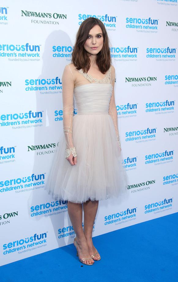 Knightly is not scared to recycle looks. Wearing her Chanel wedding dress again to events.