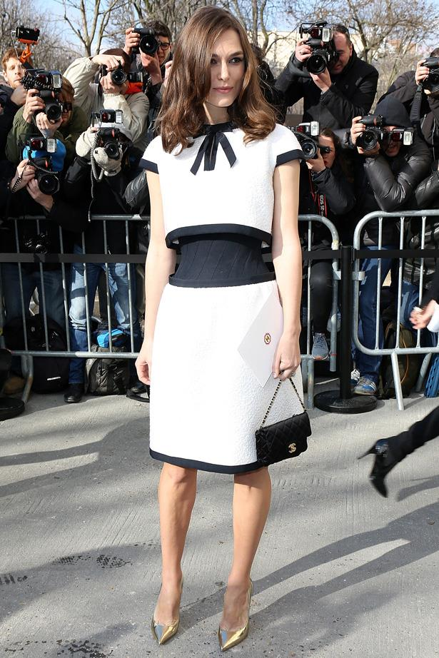 Showing off her tiny waist in Chanel.