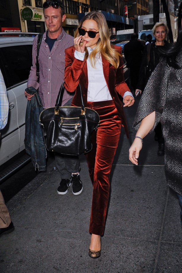 Question: what is cooler than Elizabeth Olsen striding down the street in a red crushed velvet suit? Answer: nothing.