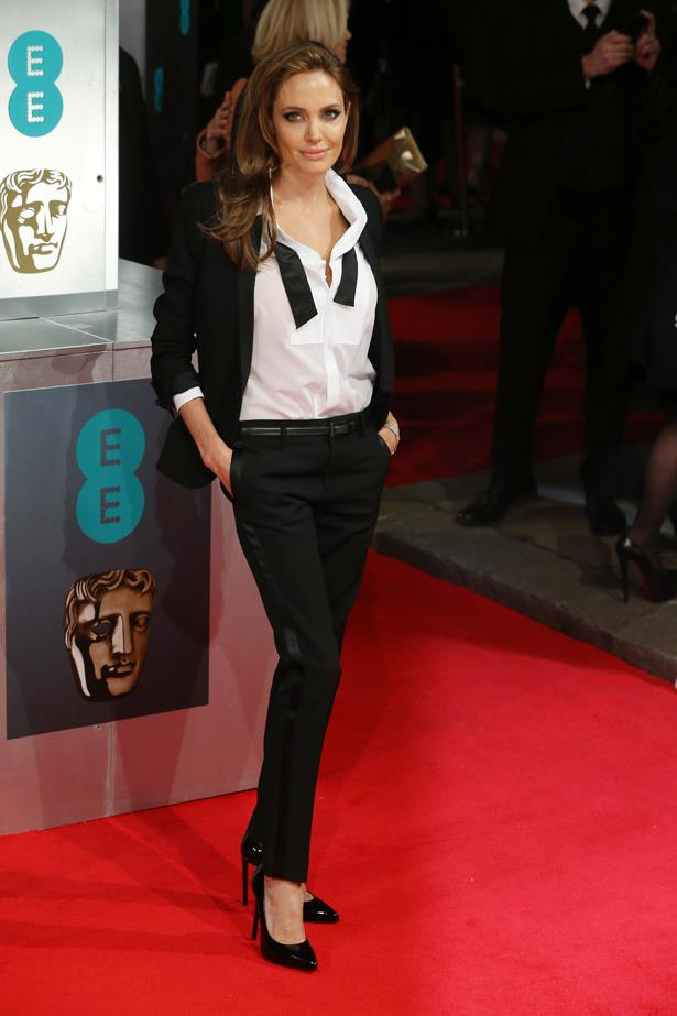 Angelina Jolie came back in fine form in this undone suit.