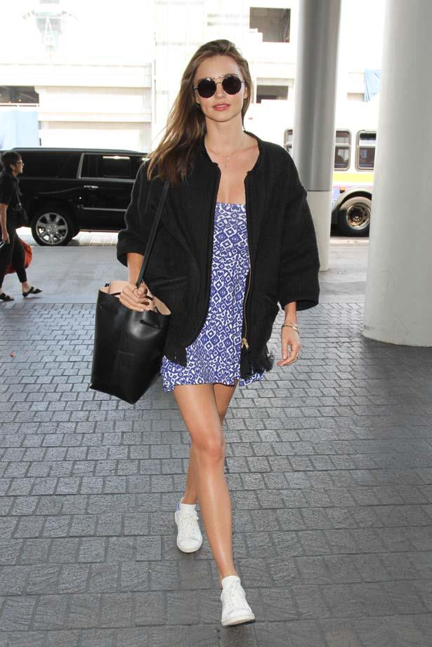 Miranda pairs Adidas sneakers with a dress, too cute.