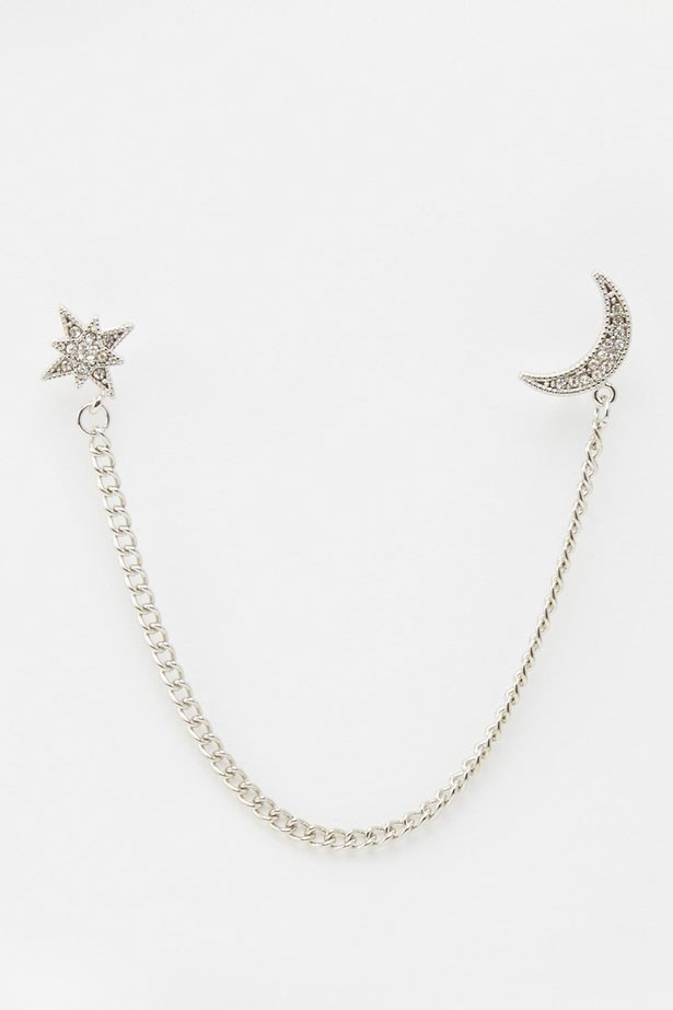 """Star & Moon Brooch, $13, Asos.com, <a href=""""http://www.asos.com/au/asos/asos-moon-and-star-connecting-brooch/prod/pgeproduct.aspx?iid=5801463&clr=Silver&SearchQuery=brooch&pgesize=21&pge=0&totalstyles=21&gridsize=3&gridrow=1&gridcolumn=3"""">asos.com/au</a>"""