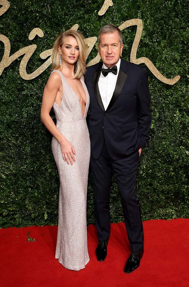 Rosie Huntington-Whiteley and Mario Testino attends the British Fashion Awards.