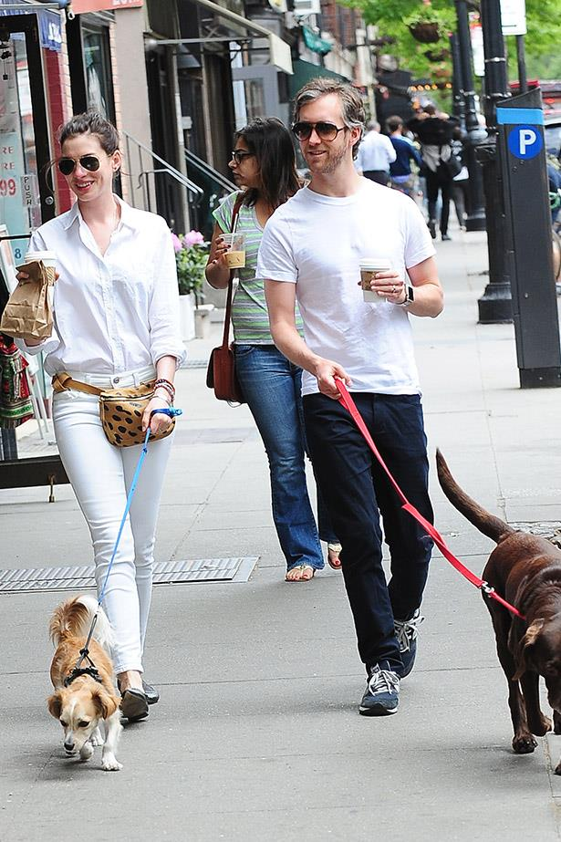 """This cute little family is set to expand with a non-furry, four-legged baby on the way for Anne Hathaway, 32, and her husband of three years Adam Shulman, 34. <br> Two sources confirmed the news to E! after Hathaway has been spotted out and about with a baby bump. <br> Hathaway has been candid in her desire to be a mother, telling Vogue in 2013, <br><br>. """"Oh, my God. I want to be a mother, and I anticipate loving my children quite fiercely. I think about it all the time, though it's a silly thing to think about because the kind of mother I'll be depends on the kind of children I have. I can't wait to meet them."""""""
