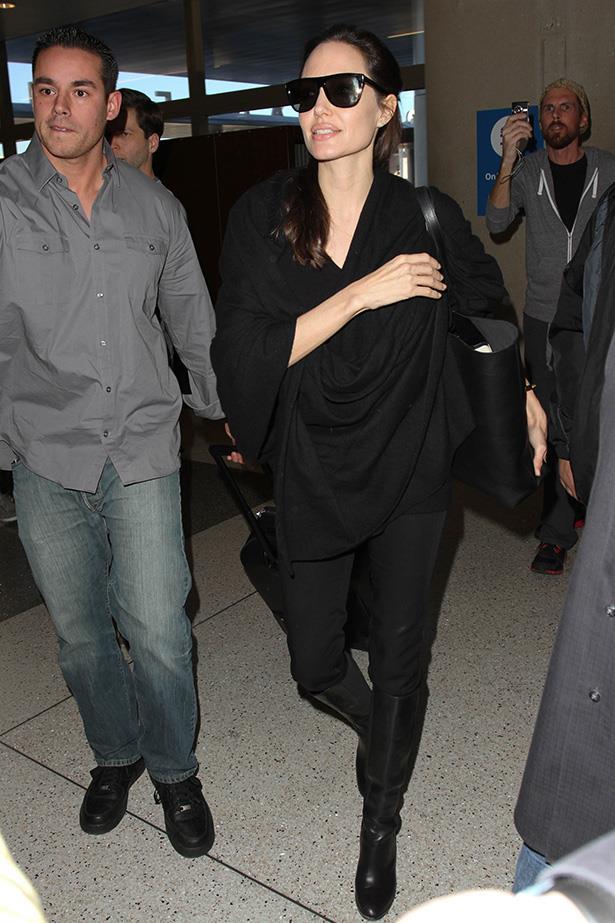 Angelina Jolie keeps a cute on the books.