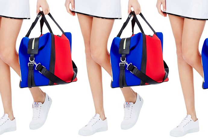 """<a href=""""https://www.modesportif.com/shop/product/tampa-bag-in-colour-block/"""">Montreal London 'Tampa Bag' in Colour Block, $800.00.</a>"""