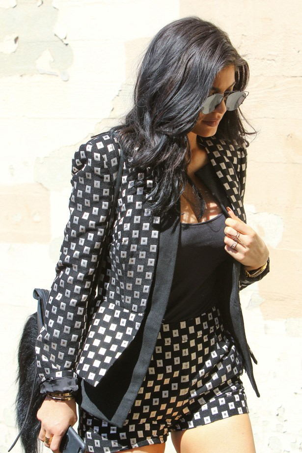 <p><strong>12. 26 July</strong></p> <p>Kylie reverts back to her natural colour and mid-length extensions.</p>