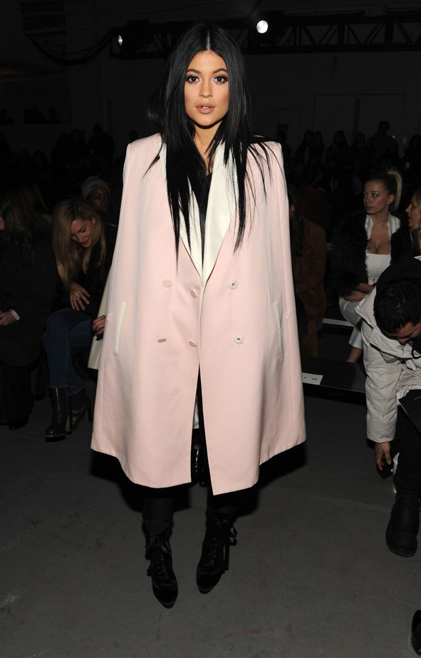 <p><strong>23. 8 February</strong></p> <p>Kylie looks like the spitting image of Kim here, poker straight locks and an oversized trench.</p>