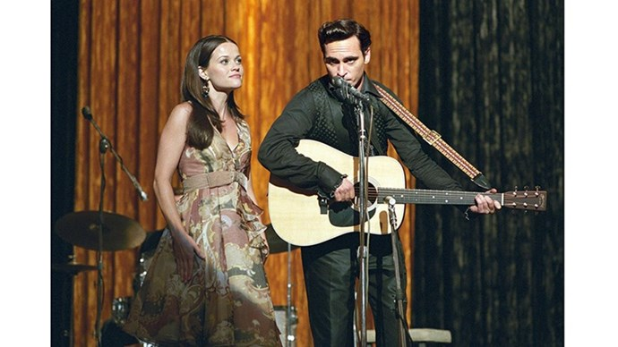 <strong>15. WALK THE LINE (2005)</strong> <br><br> The real-life romance of Johnny Cash and June Carter is one of the most romantic in music history. Reese Witherspoon and Joaquin Phoenix did so well in bringing the story to the silver screen, that Reese took home the Oscar.
