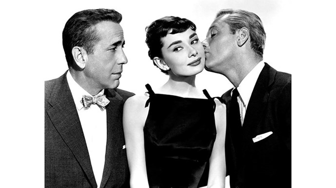 <strong>46. SABRINA (1954)</strong> <br><br> Humphrey Bogart and Audrey Hepburn = a match made in romantic comedy heaven. Bogart plays the older brother of Hepburn's initial love interest, who tries to make her fall for him to save his brother's engagement, which will ensure a great corporate deal for their family business. Of course, he actually does fall in love with her in the process.