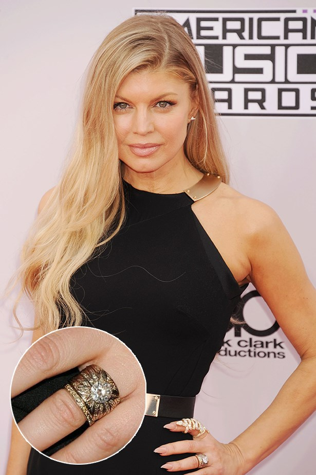 Fergie wears this thick diamond band from Josh Duhamel.