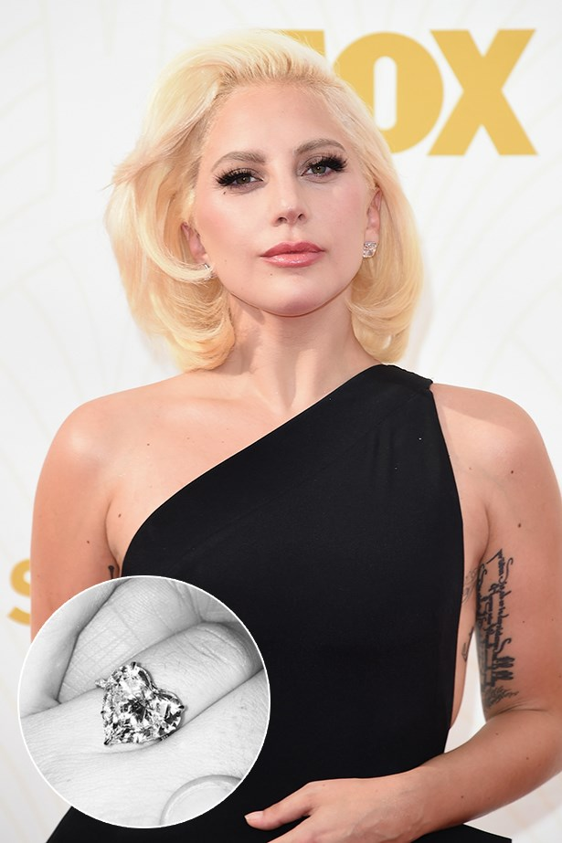 Lady Gaga wears this heart-shaped diamond with her initials in diamonds on the band.