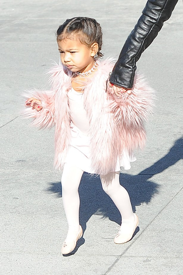 Honestly this picture of North West wearing a DIAMOND choker and pink fur coat to her ballet class is giving us so, so much joy. <br>She has no choice but to be Queen Bee or the ENTIRE WORLD right?! DutchLabUSA / Splash News