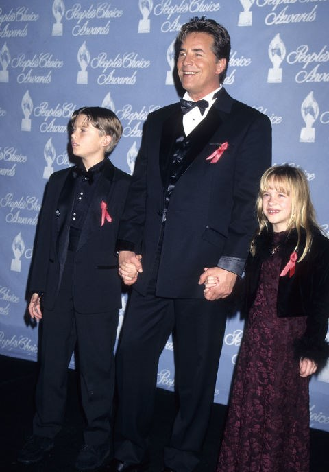 DAKOTA JOHNSON, 7, WITH HER FATHER DON JOHNSON At the 1997 People's Choice Awards. GETTY