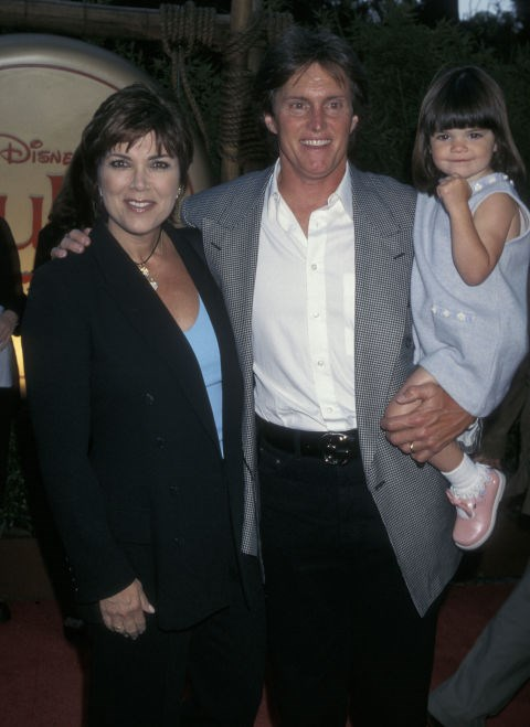 KENDALL JENNER, 3, WITH HER FATHER BRUCE JENNER AND MOTHER KRIS JENNER At the Mulan premiere in 1998. GETTY
