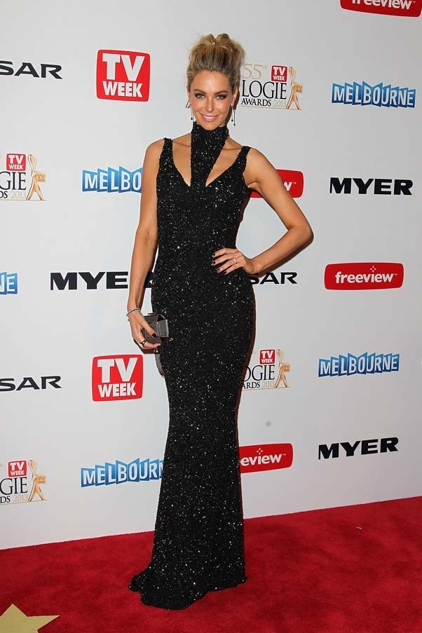 2013, April: Looking sophisticated in a glittery Jayson Brunsdon gown and box clutch at the 2013 Logie Awards in Melbourne.