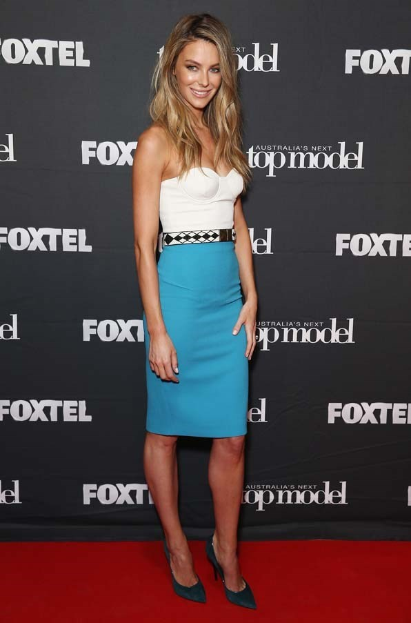 2014, October: Looking chic and modern in a blue pencil skirt and white bustier at the Australia's Next Top Model Elimination Set in Surry Hills.