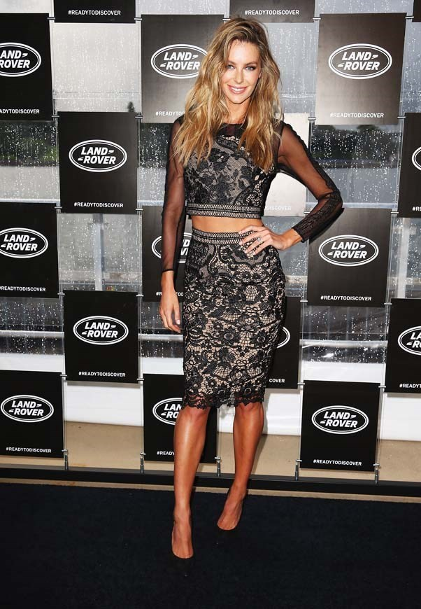 2014, December: Rocking the crop top and high waisted skirt combo at the Land Rover Discovery Sport Launch in Sydney.