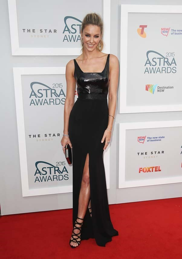 2015, March: Looking super sleek in a figure hugging Alex Perry frock at the ASTRA Awards in The Star, Sydney.