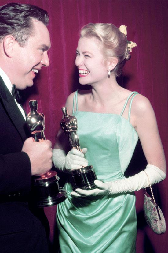 <strong>Grace Kelly at the Oscars, 1955</strong> <br><br> Grace Kelly was the epitome of old Hollywood glamour in this satin Edith Head gown.