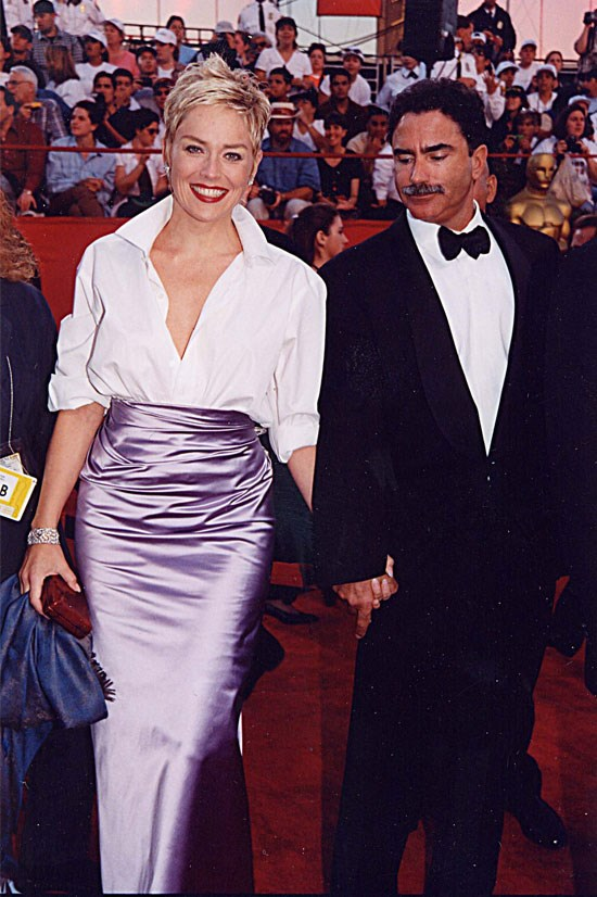 <strong>Sharon Stone at the Oscars, 1998</strong> <br><br> Sharon Stone took a risk when she wore her husband's GAP shirt with a purple Vera Wang skirt, but it totally paid off.
