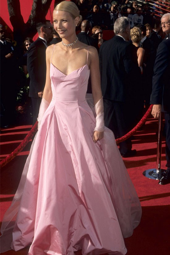 """<strong>Gwyneth Paltrow at the Oscars, 1999</strong> <br><br> Gwyneth made a lasting impression with this baby pink Ralph Lauren gown. Apparently she's <a href=""""http://www.elle.com.au/news/celebrity-news/2015/12/gwyneth-paltrow-has-already-picked-out-her-daughters-prom-dress/"""">keeping it for her daughter Apple's prom</a>!"""