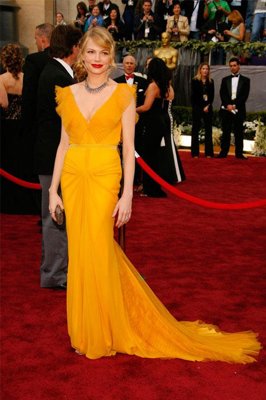 <strong>Michelle Williams at the Oscars, 2006</strong> <br><br> Michelle William was glowing in this Vera Wang gown at the 78th Academy Awards. She paired it beautifully with a red lip and messy bun.