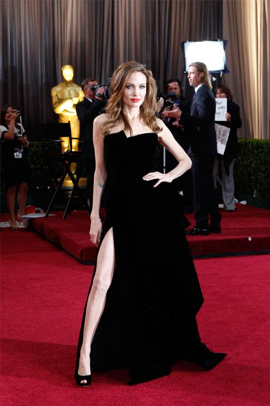 """<strong>Angelina Jolie at the Oscars, 2012</strong> <br><br> There was so much talk about this Atelier Versace thigh-revealing gown that a <a href=""""https://twitter.com/angelinajoliesl"""">twitter account was created</a> in Angelina's right leg's honour."""