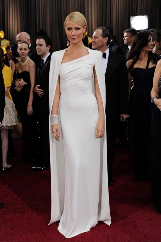 <strong>Gwyneth Paltrow at the Oscars, 2012</strong> <br><br> 2012 was a big year for iconic red carpet moments, with Gwyneth Paltrow making the list again in this much-copied by other celebs Tom Ford white cape dress.