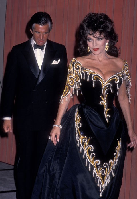 GEORGE HAMILTON AND JOAN COLLINS, 1989