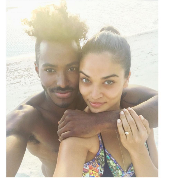 """Shanina Shaik got the best kind of Christmas pressie, a proposal and a choice of two diamond engagement rings from her partner of just over a year, DJ Ruckus (real name Greg Andrews). <br><br> The proposal happened in the Bahamas while the couple were on holiday with Andrews' family. <br> Shaik captioned this pic: This ❤️ is a sure thing! I said """"YES!!"""" @djruckusofficial 💍💏👰🏽 #loveofmylife #mrsandrews #heputaringonit #togetherforever <br><br> Congrats, lovers!"""
