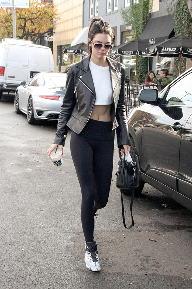 OK so Kendall Jenner is giving us TOTAL gym/abs/life goals in this casual yet carefully put-together look. Image: Getty