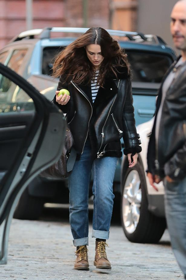 Exhibit A: Keira pairs her oversized bomber with cuffed jeans, brown boots, and a striped long-sleeve tee.