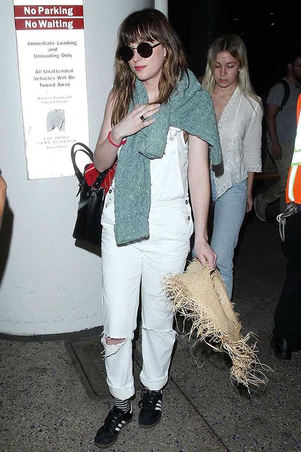 Dakota Johnson <p> <p> We're big fans of Dakota's dungaree work, and this white pair is no exception.