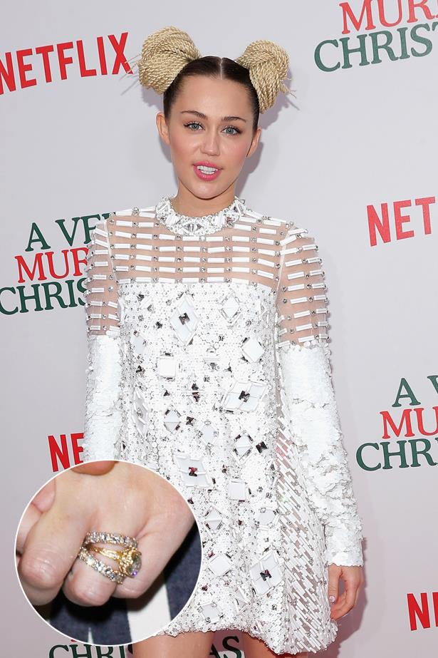 """***Miley Cyrus.***<br><Br> Throughout her on-again, off-again engagement to Liam Hemsworth, one thing has remained consistent—her  """"3.5-carat cushion-cut diamond ring, handcrafted in 18-karat gold with intricately carved diamond floral motifs in an art nouveau pattern."""" The center stone reportedly dates back to the 19th century."""