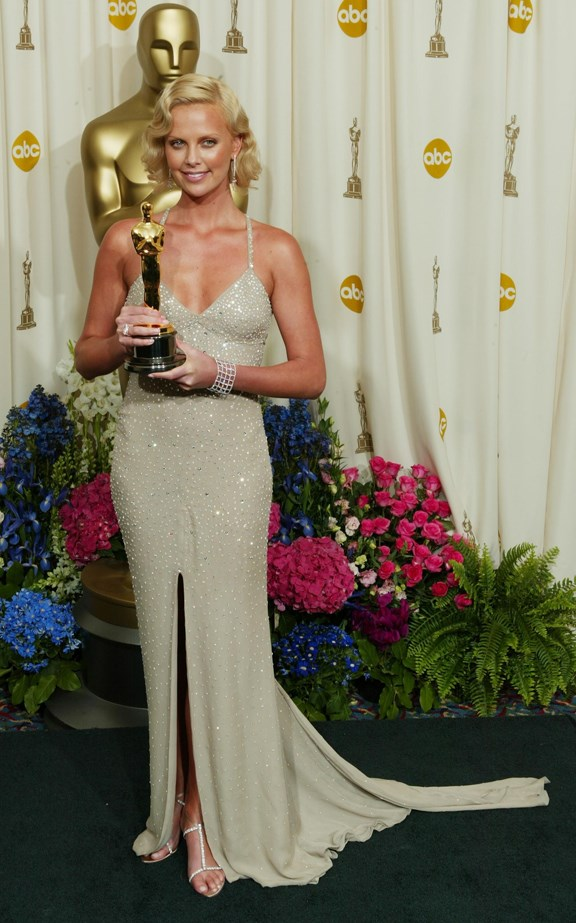 Charlize Theron wore gold Gucci to collect her gold statue in 2004.