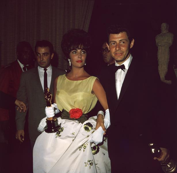 Elizabeth Taylor was never boring. She wore this white and green dress, accented with red roses, to the 1960 Awards.