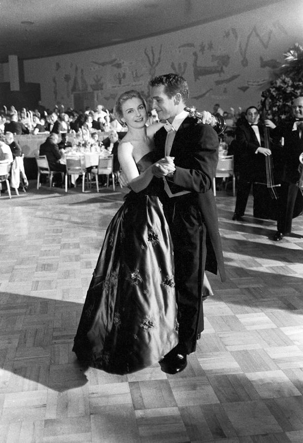 Joanne Woodward stunned in a floor-length gown with floral appliques in 1957.
