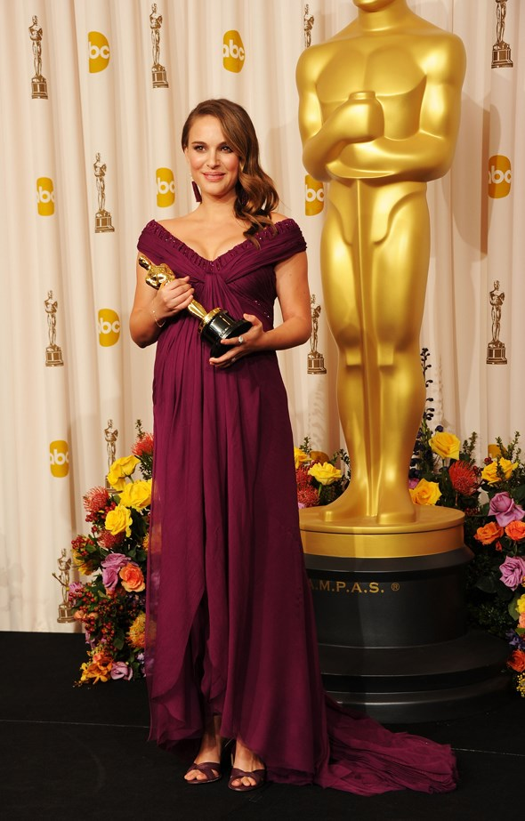 Natalie Portman dressed her baby bump in deep purple Rodarte in 2010.
