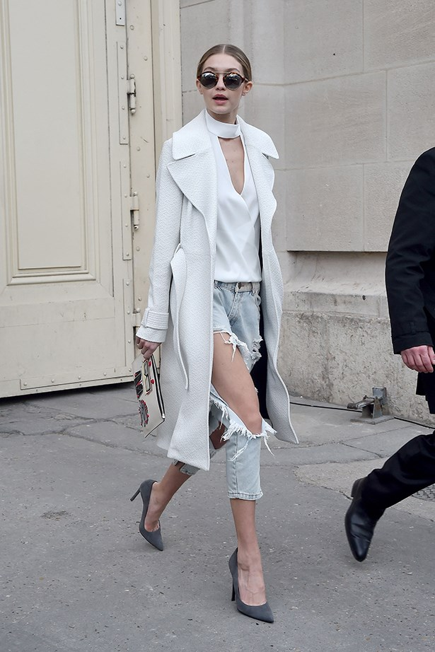 Gigi paired her One Teaspoon ripped jeans with a white cut out top, A.L.C. coat, Karl Lagergeld clutch and Illesteva sunglasses.