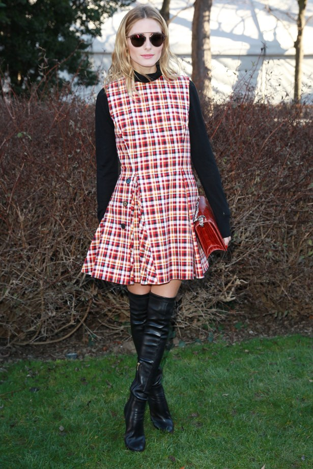 Olivia rocked her red checkered dress over a black turtleneck with knee-high boots.